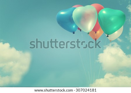 The colorful heart-shaped balloons with blue sky background in vintage style, concept of love in summer and valentine, wedding  - stock photo