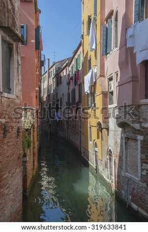 The colorful houses in tight canal , Venice. Italy  - stock photo