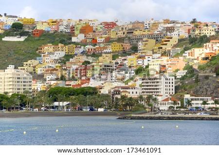The colorful houses of San Sebastian de La Gomera on the island Gomera, seen from Seaside. San Sebastian is the capital of the Island - stock photo