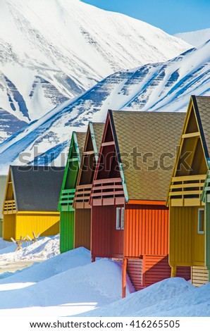 The colorful houses of the town of Longyearbyen, the largest settlement and the administrative center of Svalbard, Norway - stock photo