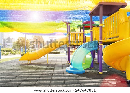 The colorful playground for kids at the park - stock photo