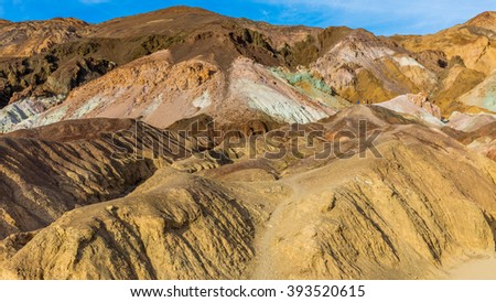 The colorful rocks located in Artist loop drive, Death Valley National Park. A part of one way scenic drive. The colors are created by different minerals. Artist's Drive, Death Valley National Park - stock photo