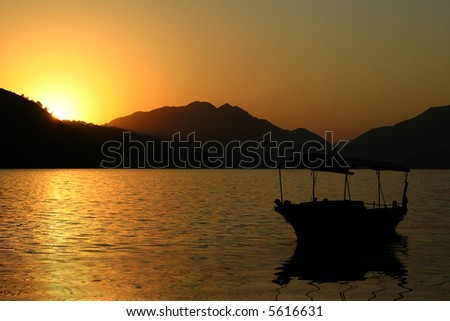 The colorful sunrise under mountains and sea