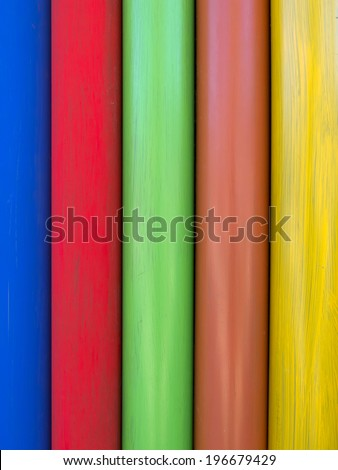 The colorful wood background and texture.