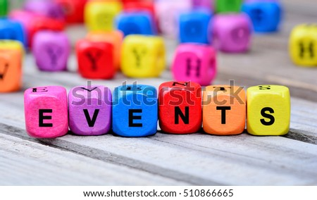The colorful word Events on wooden table
