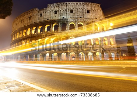 The Colosseum at night and traffic lights - stock photo