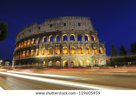 The Colosseum, famous and representative monument of ancient Rome and the splendor of the Roman Empire. Night view. Italy - stock photo