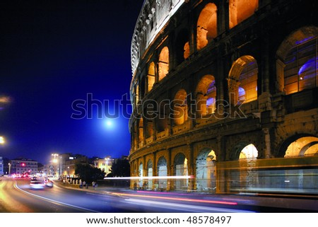 The Colosseum or Roman Coliseum, originally the Flavian Amphitheatre, is an elliptical amphitheatre in the center of the city of Rome, Italy, the largest ever built in the Roman Empire. - stock photo