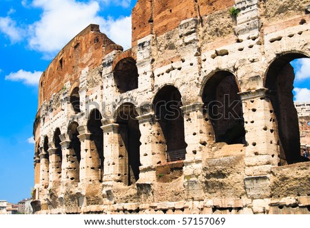 the colosseum with blue sky, Rome, Italy - stock photo