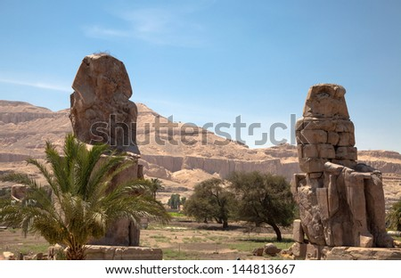 The Colossi of Memnon - two massive stone statues of Pharaoh Amenhotep III - Egypt, Luxor.