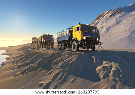 The column of trucks mountains in the background. - stock photo