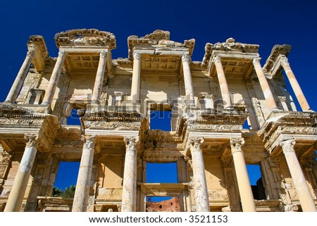 The Columns of the Celsus Library of Ancient Ephsus in Ksadasi Turkey - stock photo