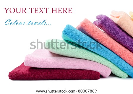 The combined colour towels isolated on white - stock photo