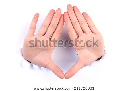 The combined hands, are forming a triangle  from hole - stock photo