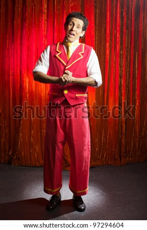 The comedian in the box on stage in theater - stock photo