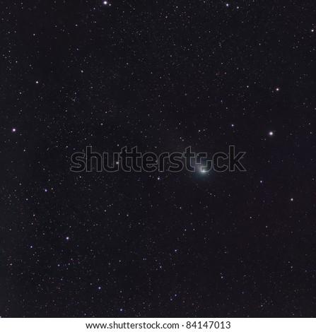 The Comet Garradd Streaking Through the Constellation Sagita - stock photo