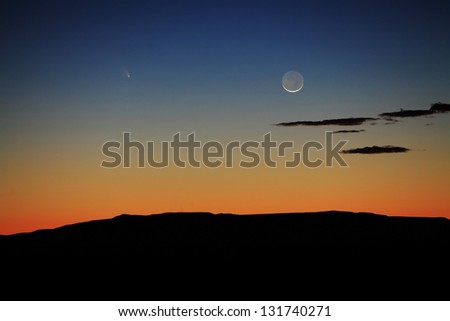 The comet Panstarrs and the setting Crescent Moon from General Nathan Twinning Observatory in Belen, New Mexico on March 12, 2013. - stock photo