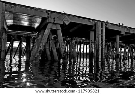 The commercial shipping dock in Homer, Alaska as seen by boat in black and white. - stock photo