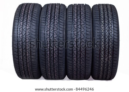 The complete set of new tyres for the car on a white background - stock photo