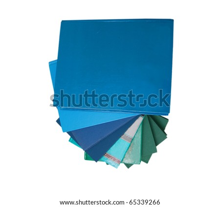 the completed blue books on white - stock photo