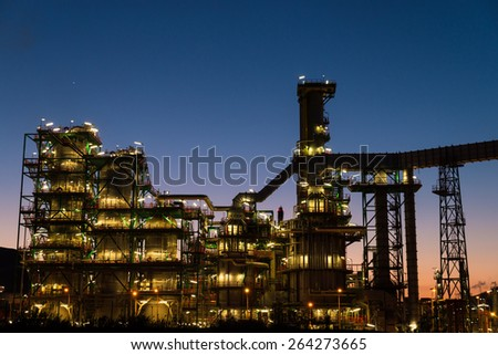 The complex structures of a petrochemical plant at dusk - stock photo