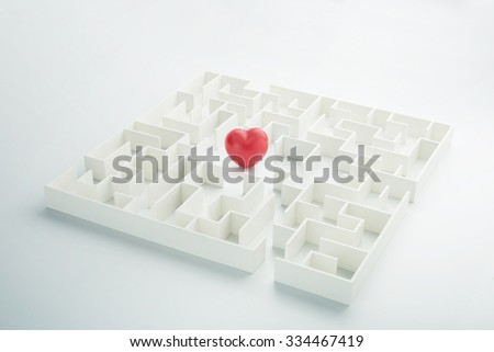 The complex world of emotions. Red heart hidden inside a maze - stock photo