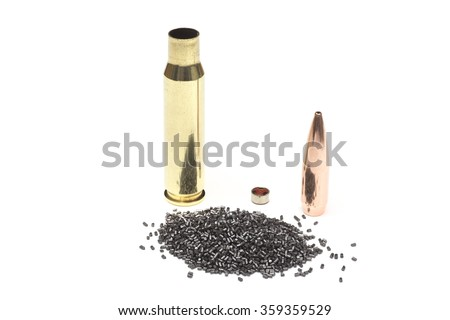 The components required to build a rifle cartridge including a bullet, brass case, smokeless powder and a primer. - stock photo