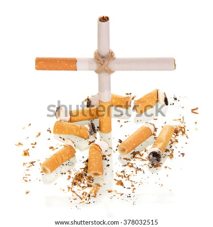The composition in the form of a cross, and smoked a cigarette isolated on white background - stock photo