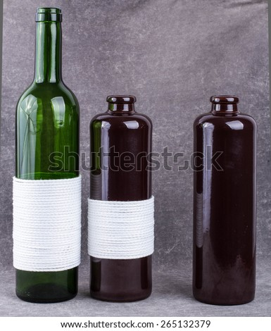 The composition of decorative bottles, glass and ceramics. - stock photo