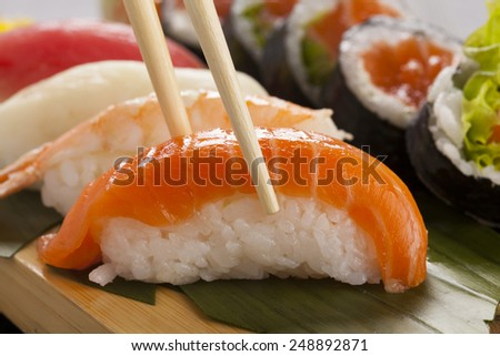The composition of nigiri sushi with tuna, salmon, shrimp, butterfish on rice  - stock photo