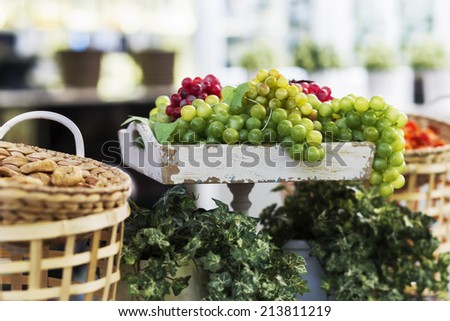 the composition of the basket and grapes on the old tray - stock photo