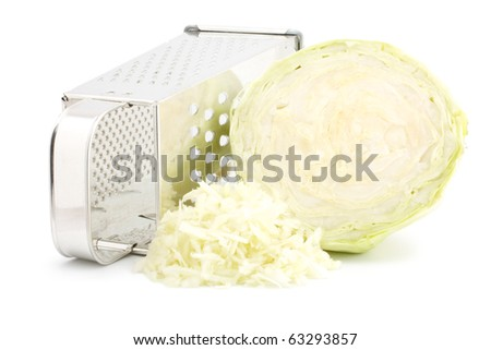 The composition of the grated cabbage. Nearby is grater and cabbage. Isolated on white background.