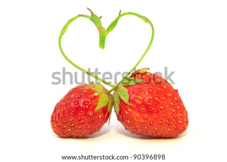 The composition of two strawberries with  stalk in form of heart - stock photo