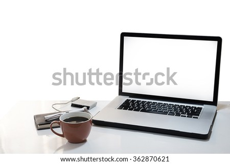 The computer is on the work table isolated white background. - stock photo