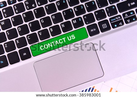 The computer keyboard button written word contact us