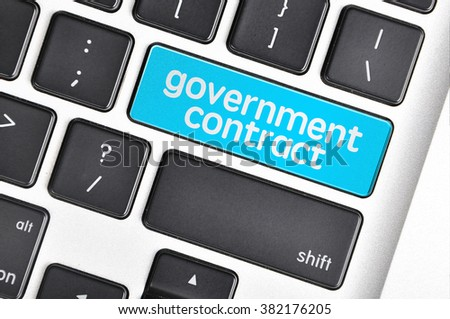 The computer keyboard button written word government contract . - stock photo