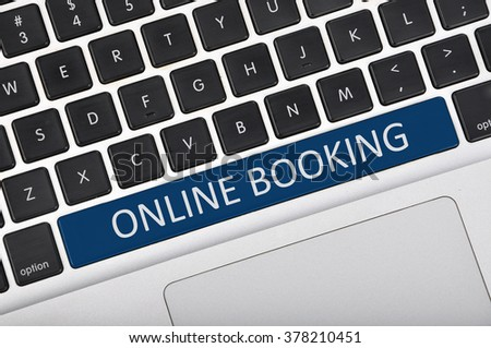 The computer keyboard button written word online booking .