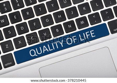 The computer keyboard button written word quality of life .