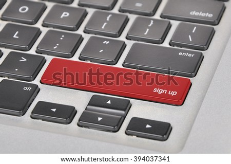 The computer keyboard button written word sign up . - stock photo