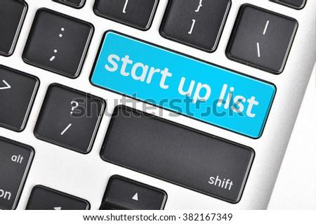 The computer keyboard button written word  start up list. - stock photo