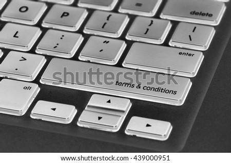 The computer keyboard button written word terms & conditions .