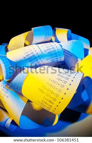 the computing strips have a calculator calculates the costs and profits. - stock photo