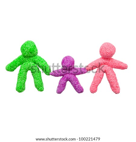 The concept of a happy family, made of colorful foam clay. Three figures, symbolizing the mother, father and baby, holding hands. - stock photo