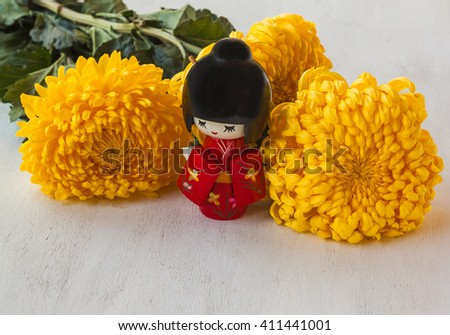 The concept of a Japanese holiday chrysanthemums  of the ninth lunar month of the traditional Japanese doll Kokeshi (mass production)