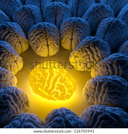 The concept of a unique intelligence and original idea - a brain emits luminous energy, and ordinary brains gathered around - stock photo