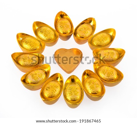 The concept of charitable donations , Chinese gold ingots and a heart-shaped white background  - stock photo