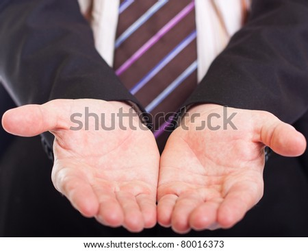 The concept of giving - Businessman's open palm. - stock photo