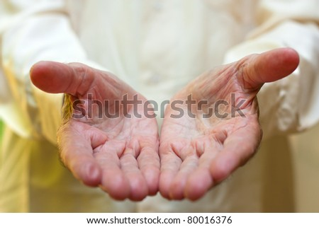 The concept of giving - Elderly man's hands. - stock photo