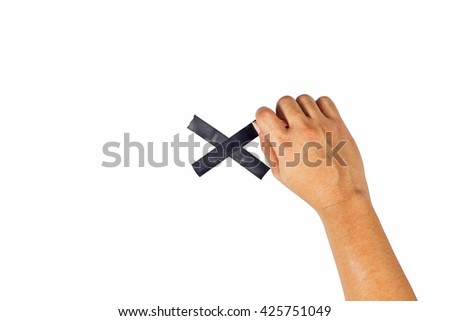 The concept of hands is about to taped to a black x sign. - stock photo