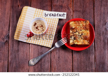 The concept of lunch, warm and homely atmosphere and a dessert.  Apple pie and a cup of cappuccino on the table, top view. - stock photo